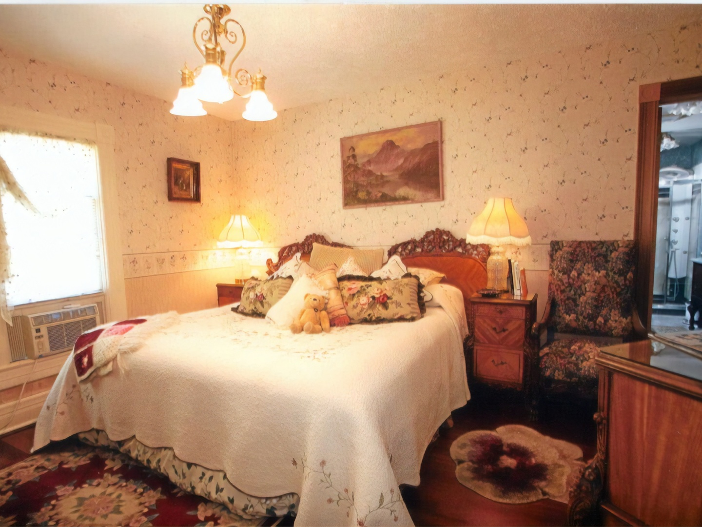 A bedroom with a bed and a fireplace at TC Smith Historic Inn.