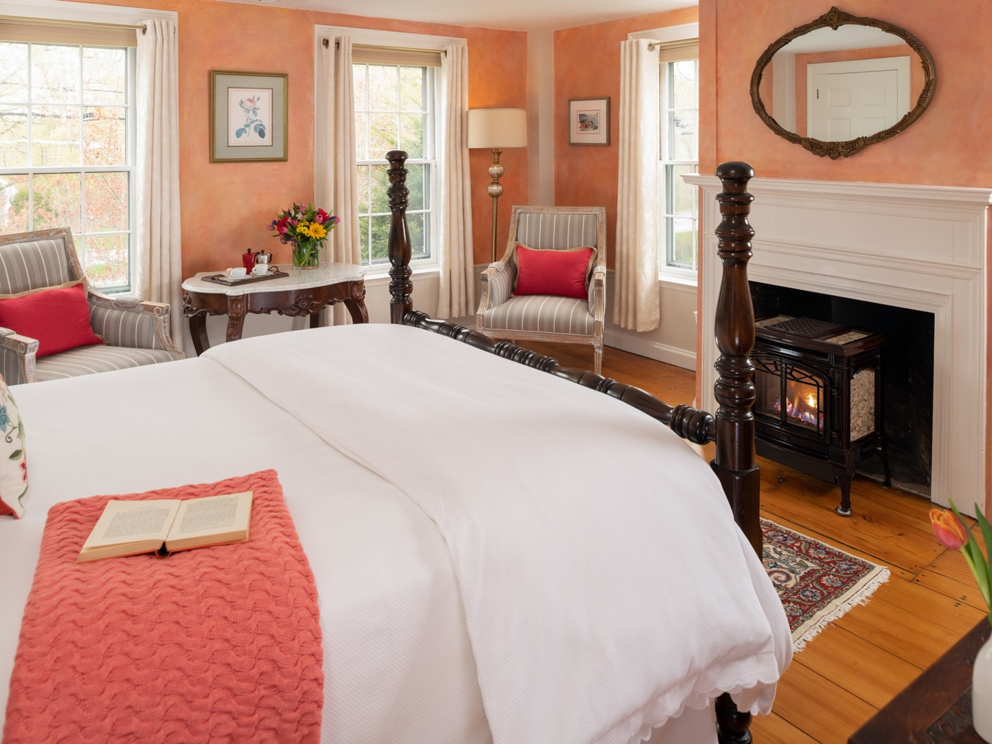 A bedroom with a large bed in a room at Candleberry Inn on Cape Cod.