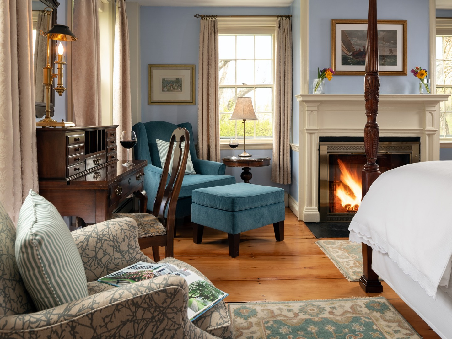 A living room filled with furniture and a fire place at Candleberry Inn on Cape Cod.