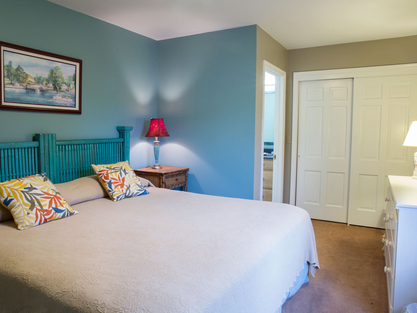 A bedroom with a bed in a room at Sandaway Suites & Beach.
