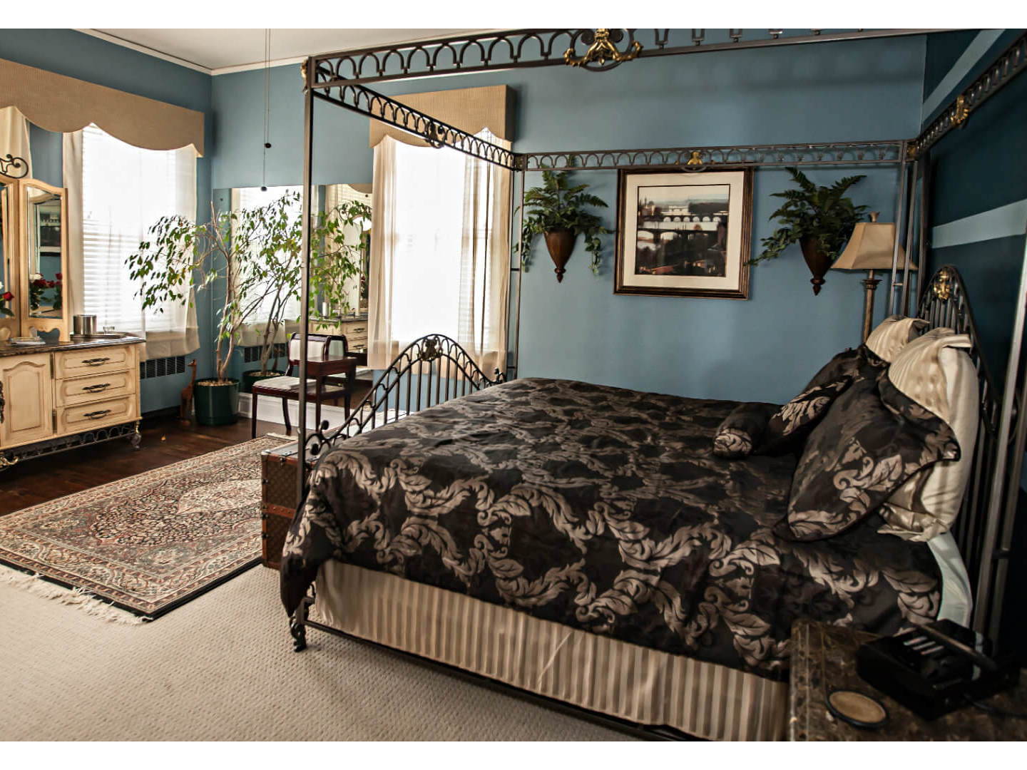A bedroom with a large bed in a room at Morehead Manor Bed and Breakfast.