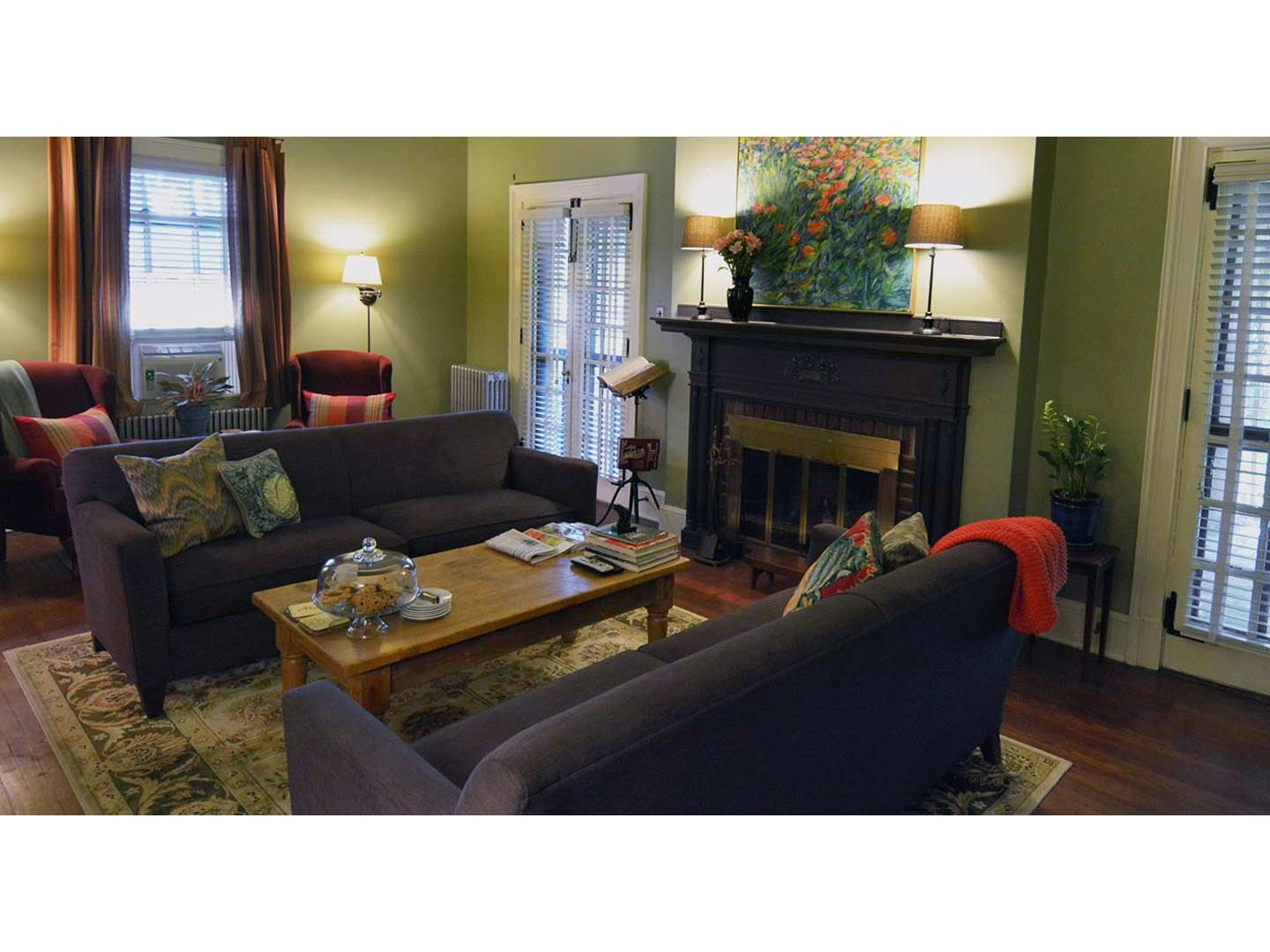 A living room filled with furniture and a flat screen tv at The Lancaster Bed and Breakfast.