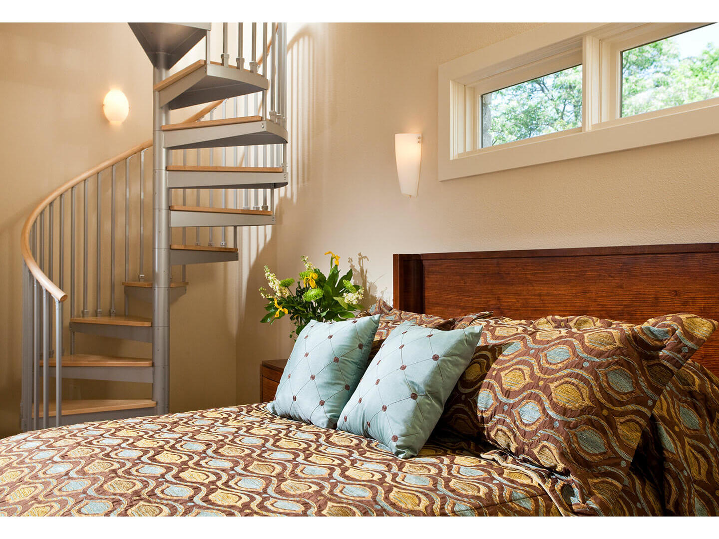 A bedroom with a bed and a chair in a room at Inn on Lake Granbury.