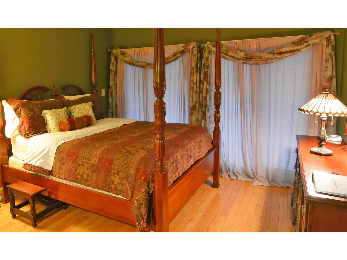 A bedroom with a bed in a room at Pilot Knob Inn.