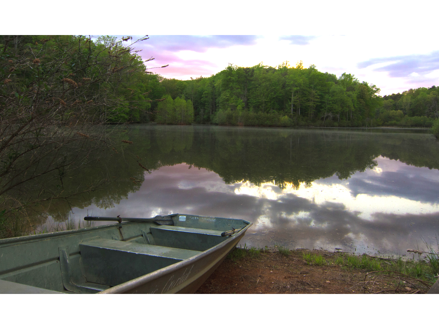 A small boat in a body of water at Pilot Knob Inn.