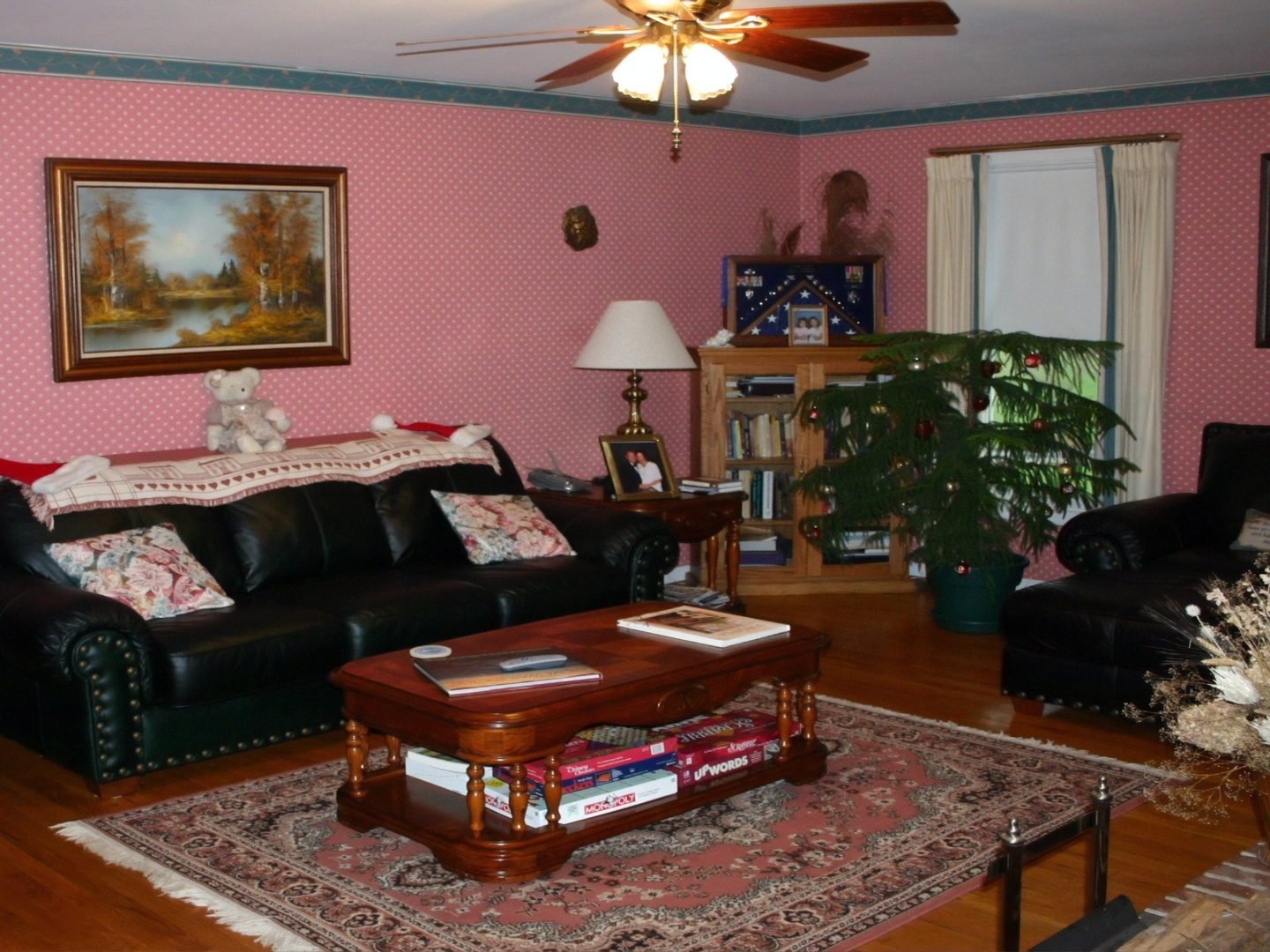 A living room filled with furniture and a flat screen tv at Middle Grove Inn.