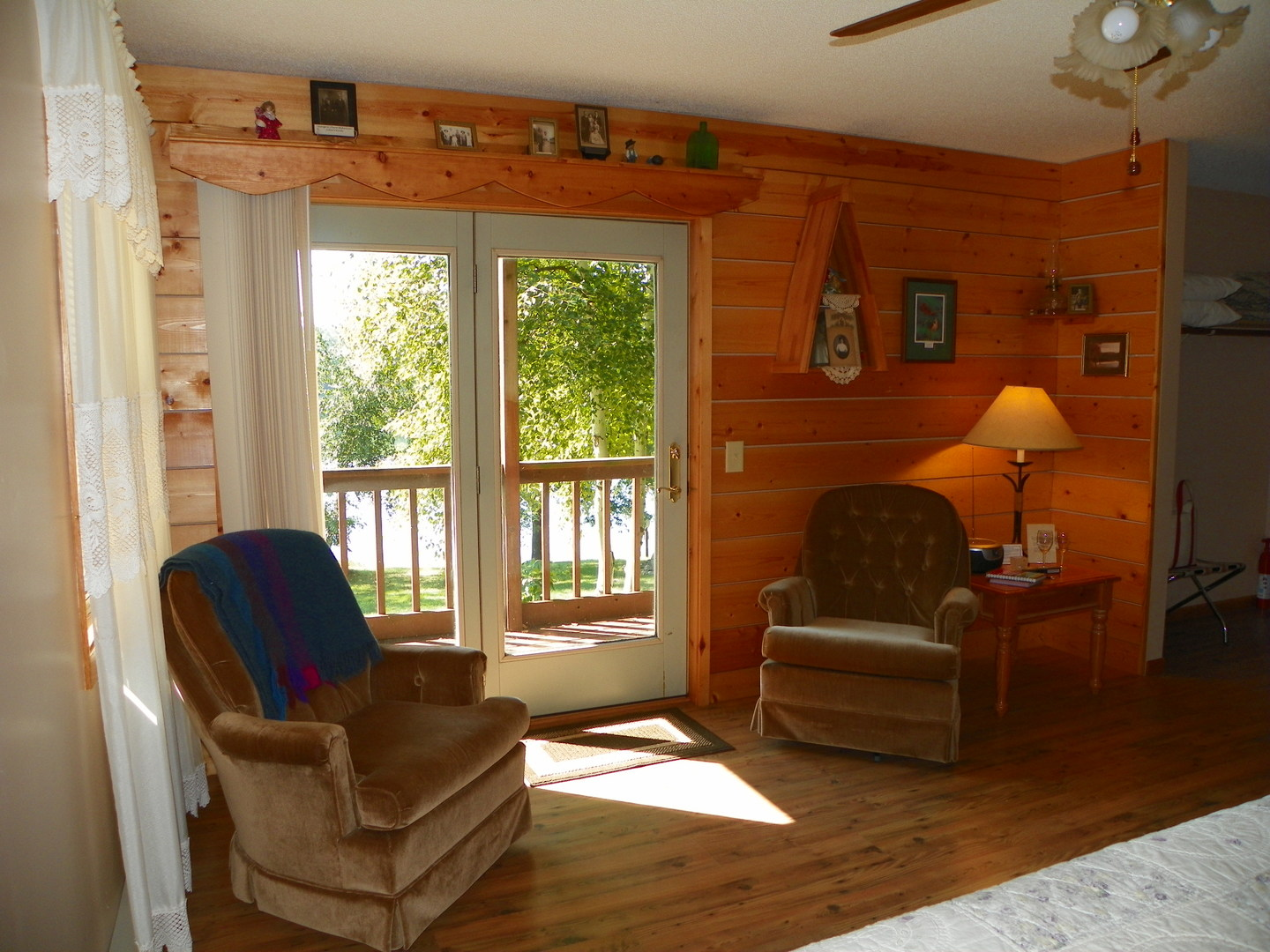 A view of a living room filled with furniture and a large window at Pleasant Lake Bed & Breakfast.