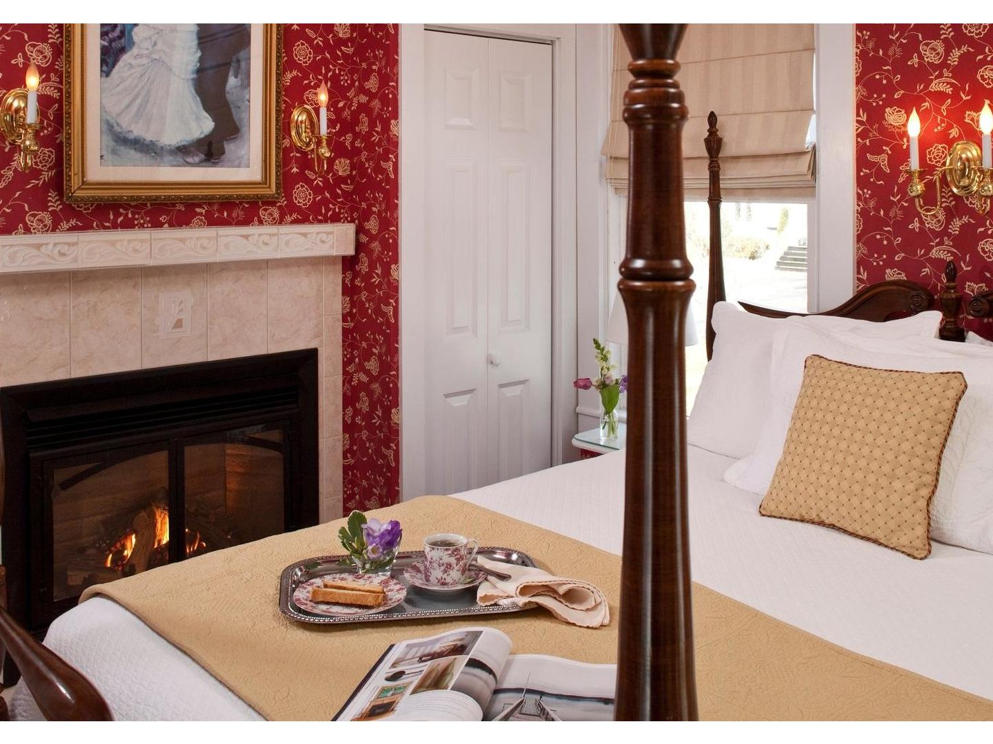 A fire place sitting in a living room at Maine Stay Inn & Cottages.