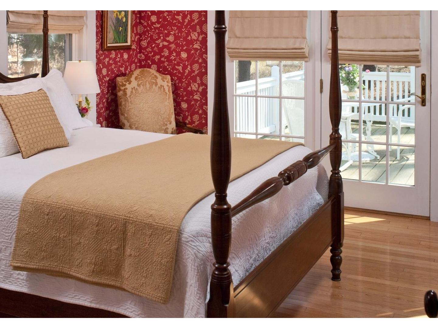 A bedroom with a bed and a window at Maine Stay Inn & Cottages.