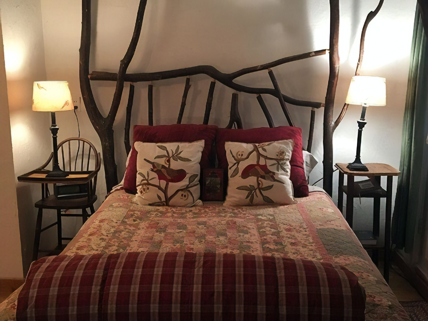 A bedroom with a bed and a chair in a room at Country Woods Inn.