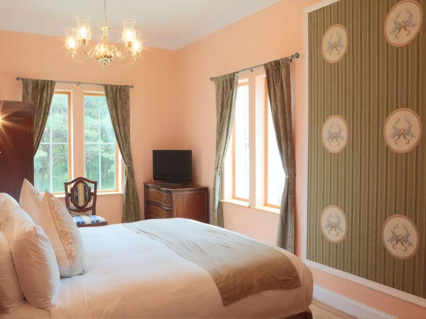 A bedroom with a large bed sitting in a room at Wedmore Place.