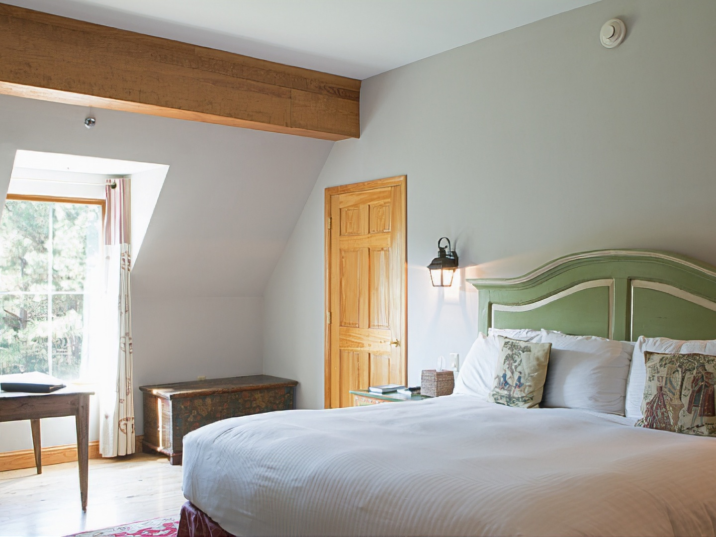 A bedroom with a large bed in a hotel room at Wedmore Place.