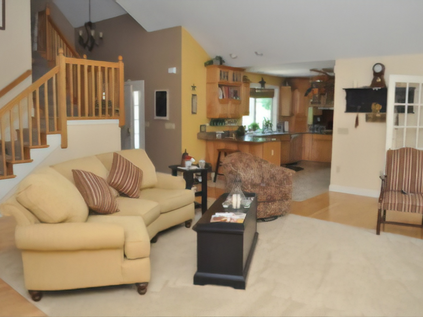 A living room filled with furniture and a fireplace at Hammer Creek Hideaway Bed & Breakfast.