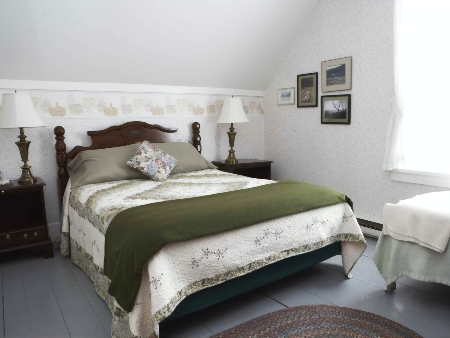 A bedroom with a large bed in a room at Liberty Hill Farm.