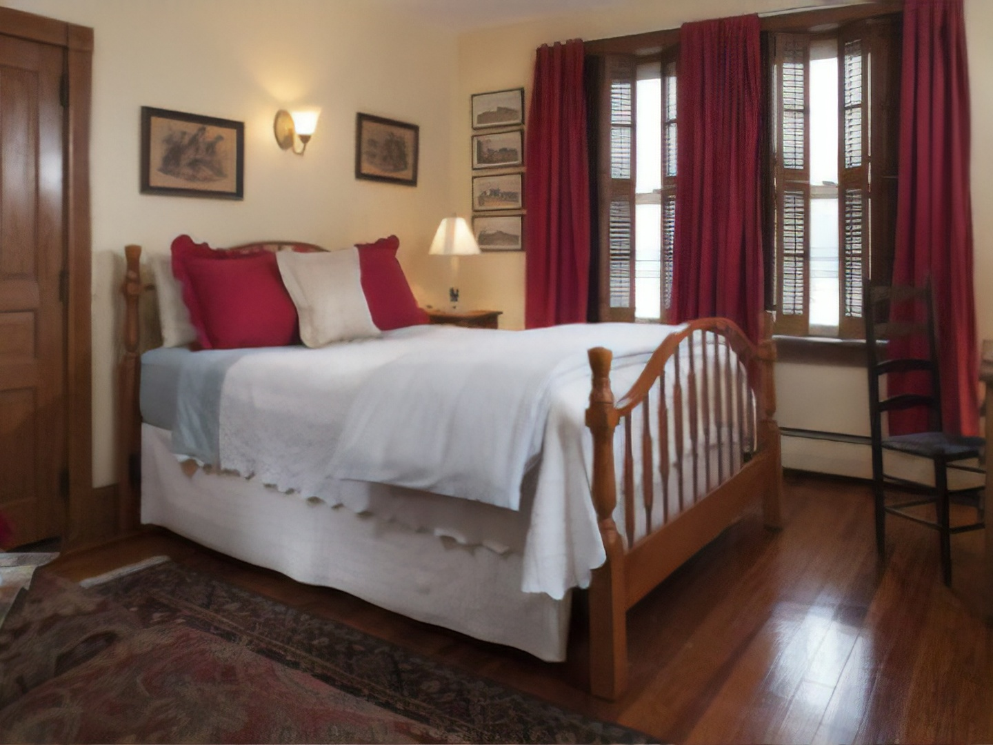 A bedroom with a large bed in a room at Harvest Moon Bed & Breakfast.