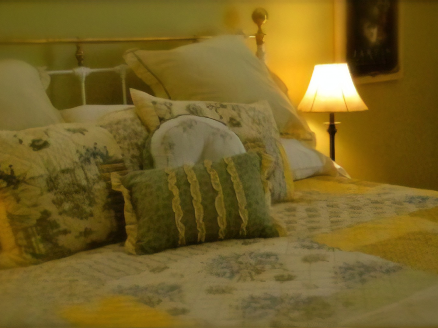 A bedroom with a bed and a lamp in a room at Longview Farms Bed & Breakfast Carriage House.