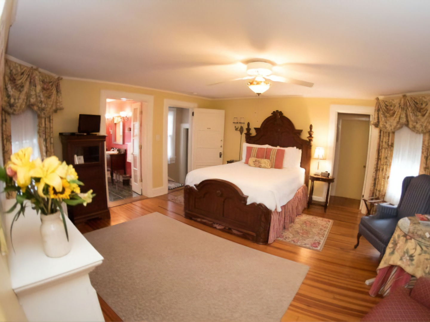 A living room filled with furniture and a fireplace at Pinecrest Bed & Breakfast.