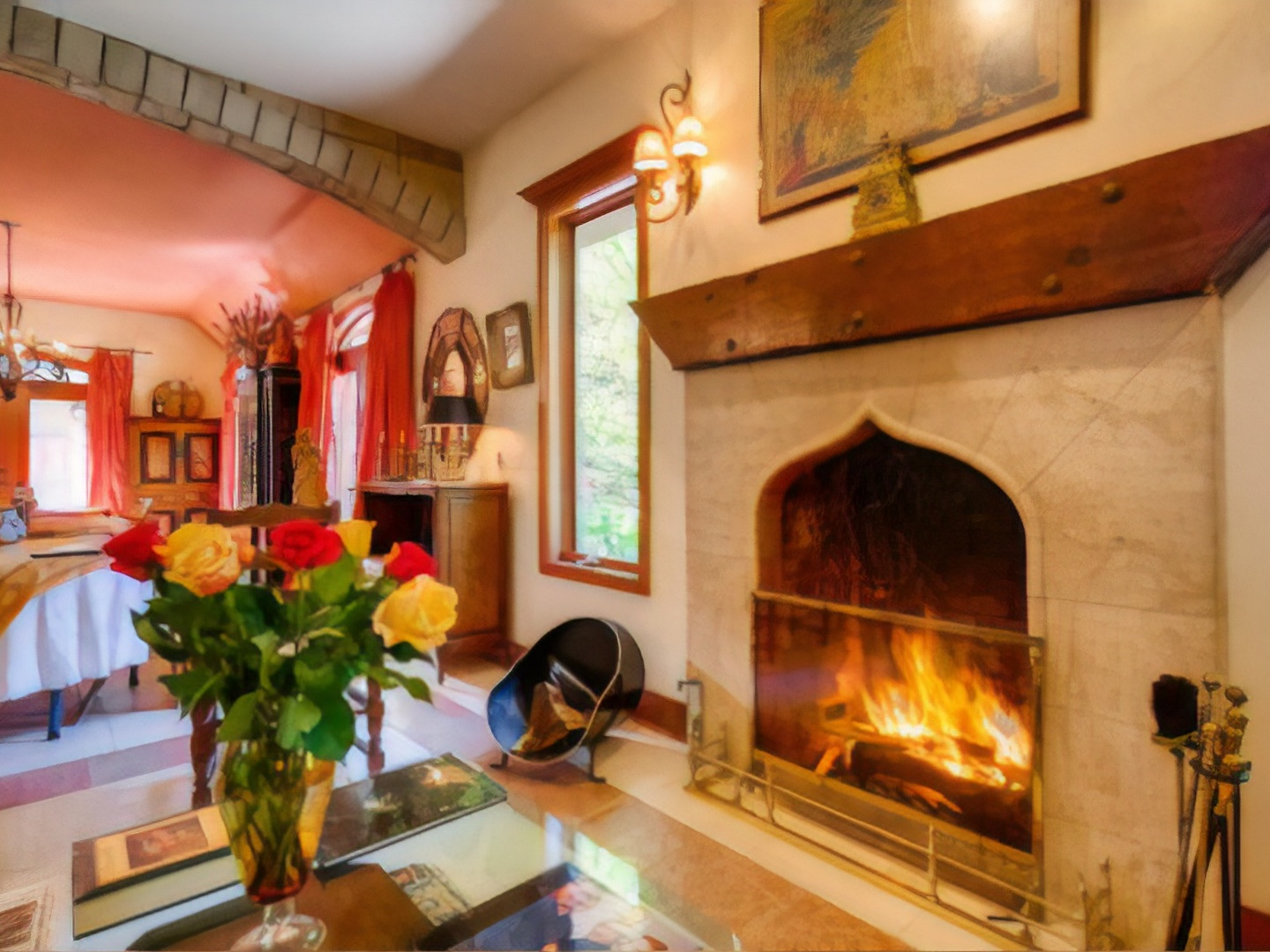 A fire place and a fireplace at Auberge de Seattle French Country Inn in Woodinville, WA..