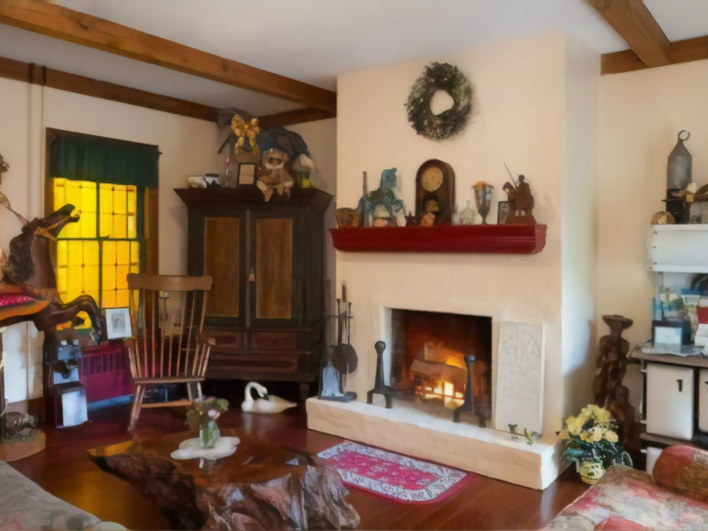 A living room filled with furniture and a fire place at The Widow McCrea House Victorian B&B.
