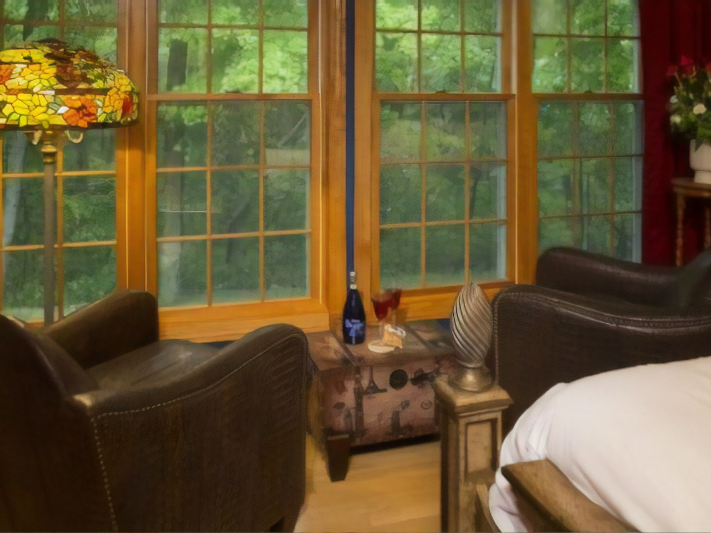 A living room filled with furniture and a large window at Hidden Serenity Bed & Breakfast.