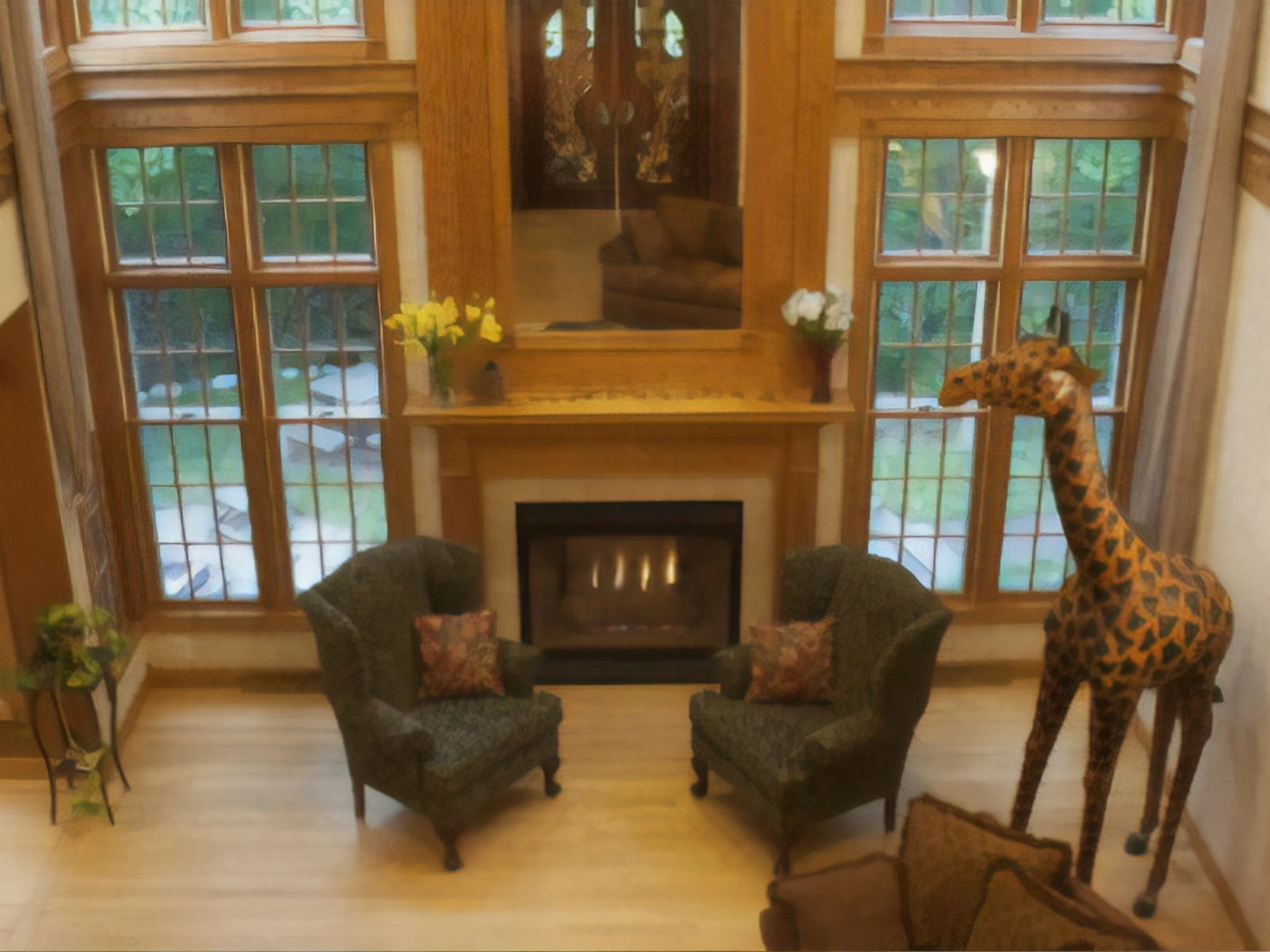 A living room filled with furniture and a fire place at Hidden Serenity Bed & Breakfast.