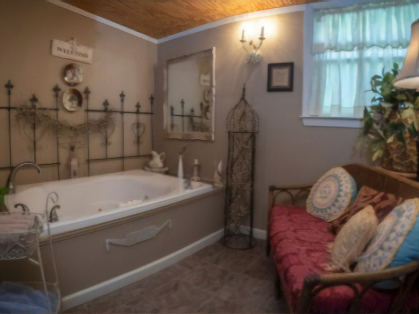 A bedroom with a large mirror at Country Charm Bed and Breakfast.