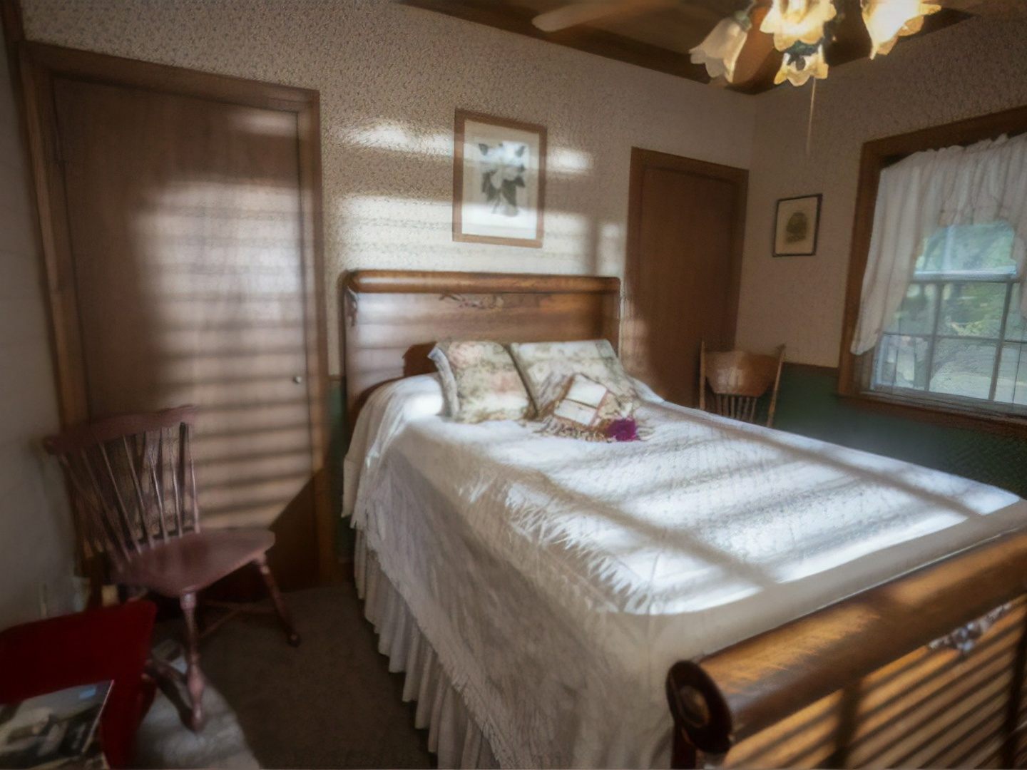 A bedroom with a bed and desk in a room at Country Charm Bed and Breakfast.