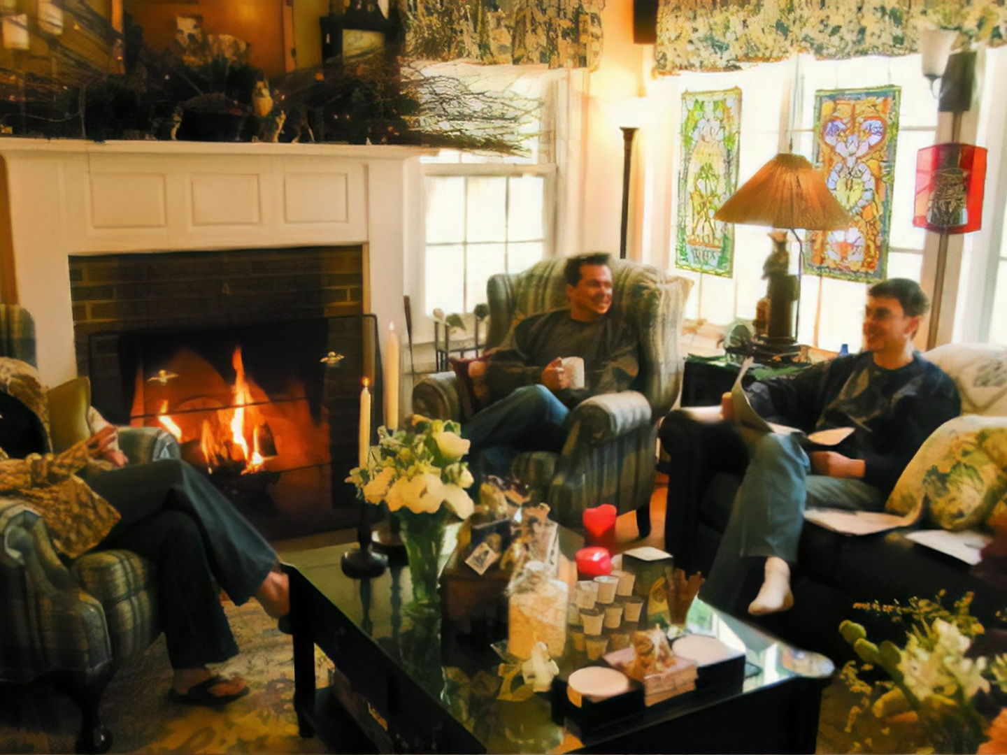 A group of people sitting around a living room at Phineas Swann Inn & Spa.