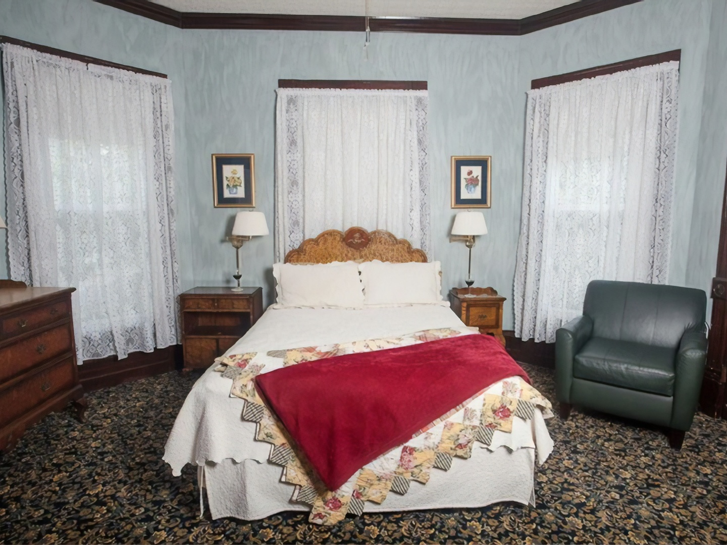 A bedroom with a large bed sitting in a room at Market Street Inn Bed and Breakfast.