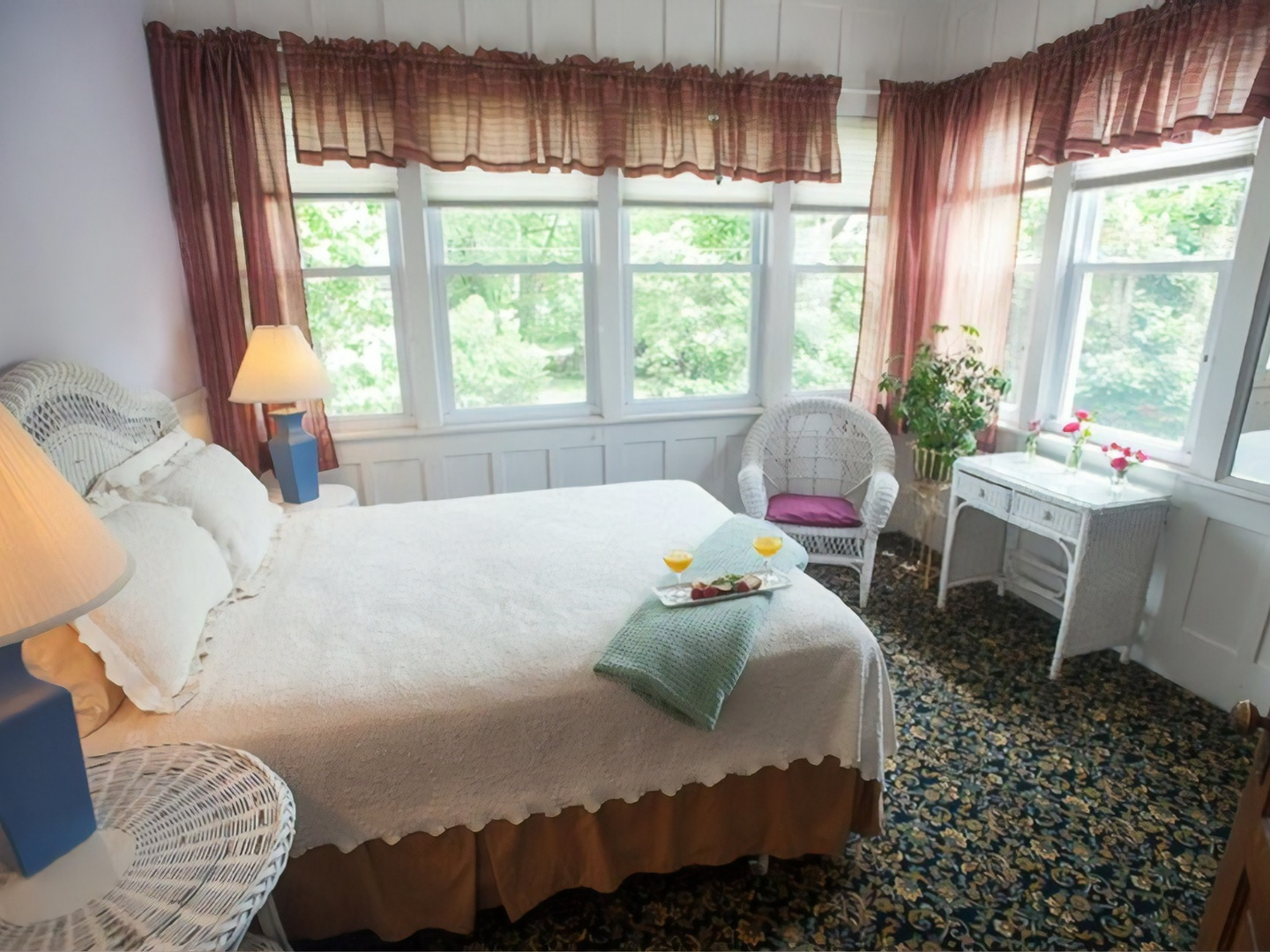 A bedroom with a bed and a large window at Market Street Inn Bed and Breakfast.
