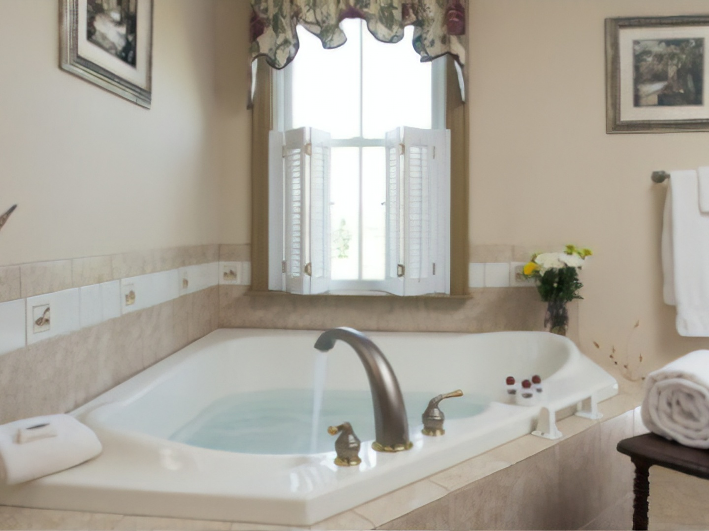 A large white tub sitting next to a sink at Pheasant Field Bed and Breakfast.