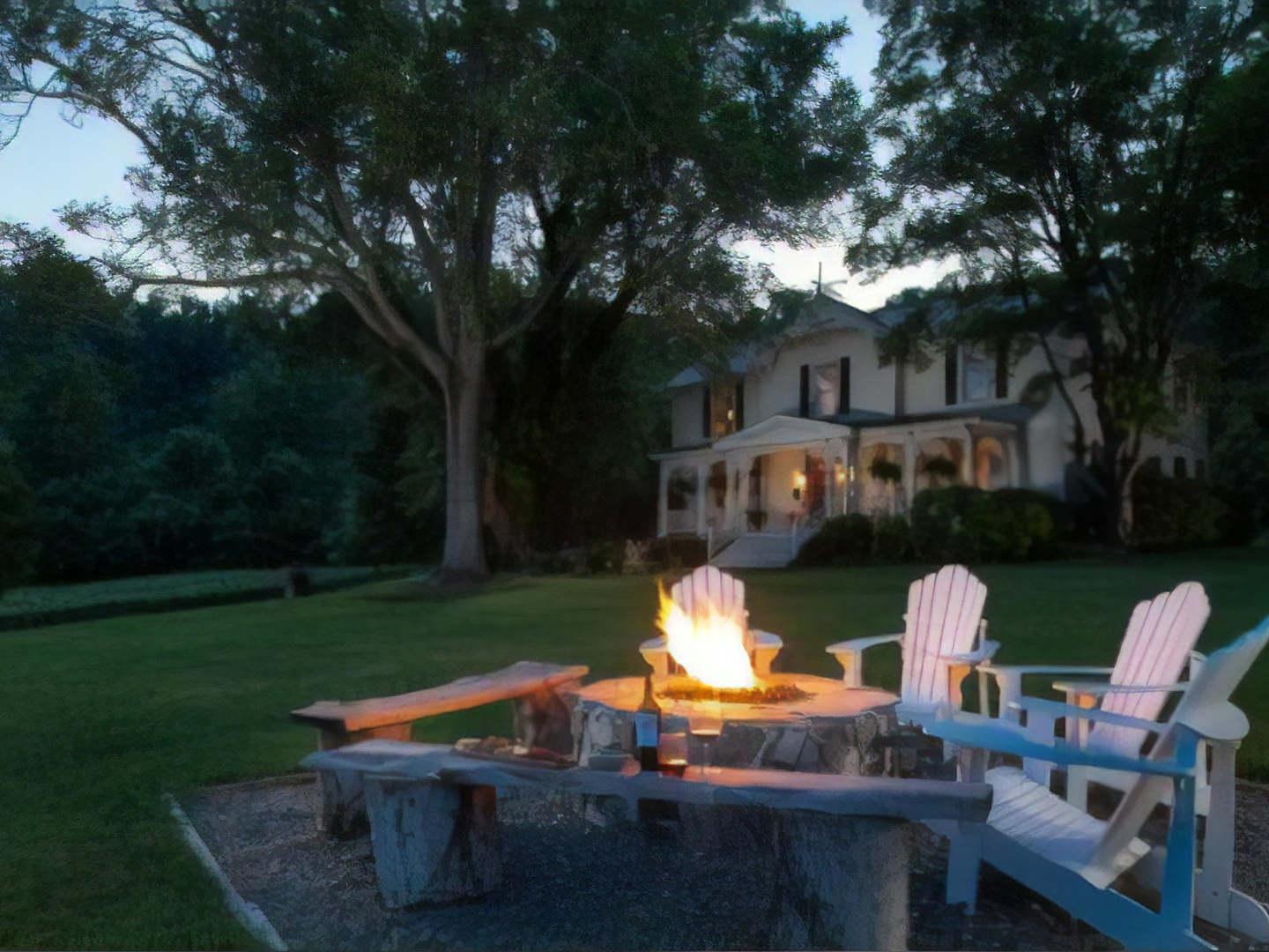 A person sitting at a picnic table at Orchard House Bed & Breakfast.
