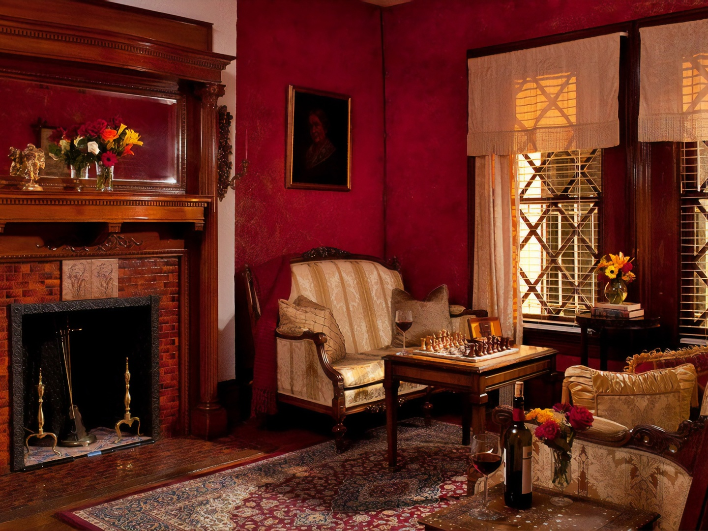 A fireplace in a living room filled with furniture and a fire place at American Guest House.