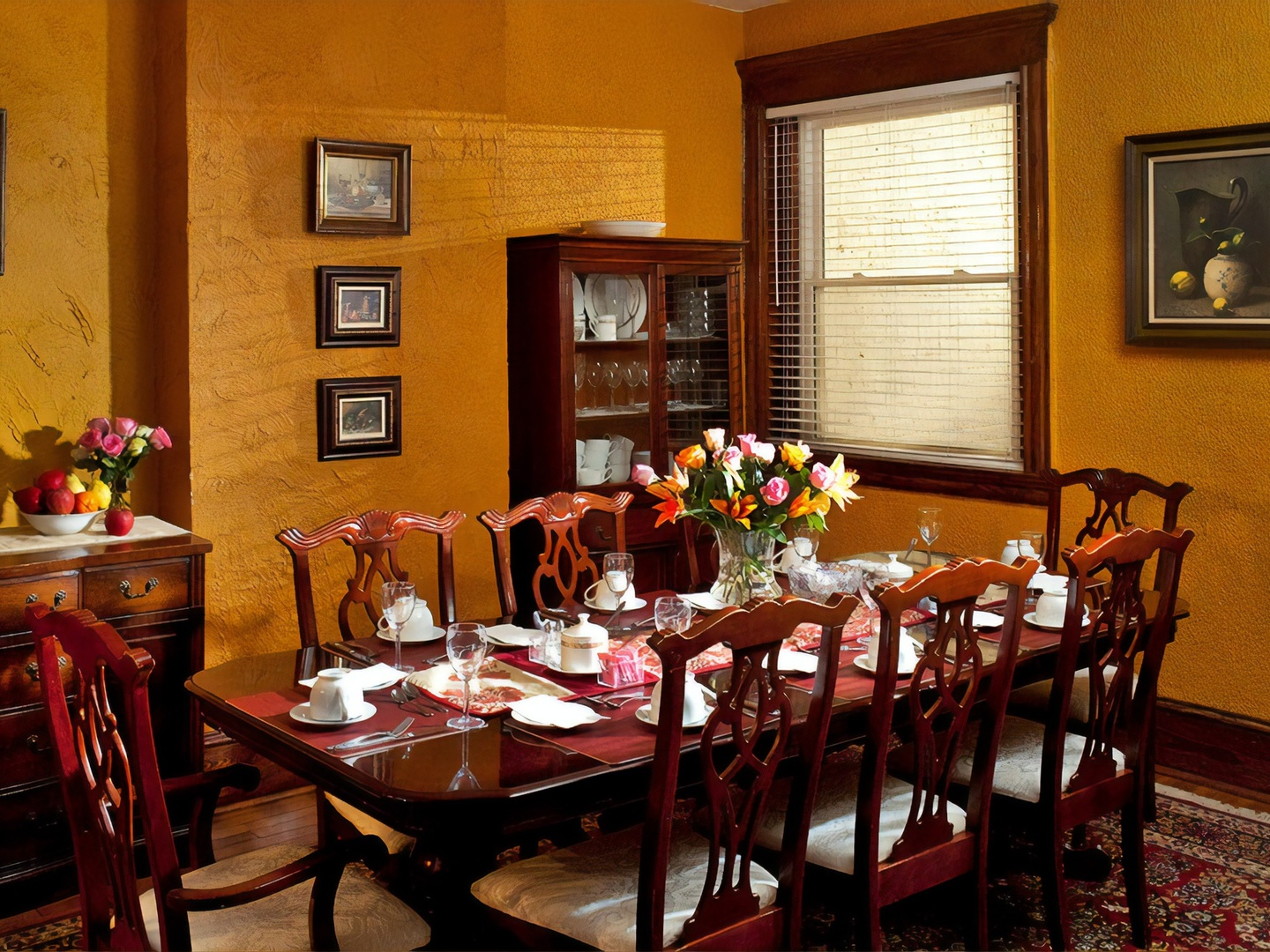 A dining room table at American Guest House.