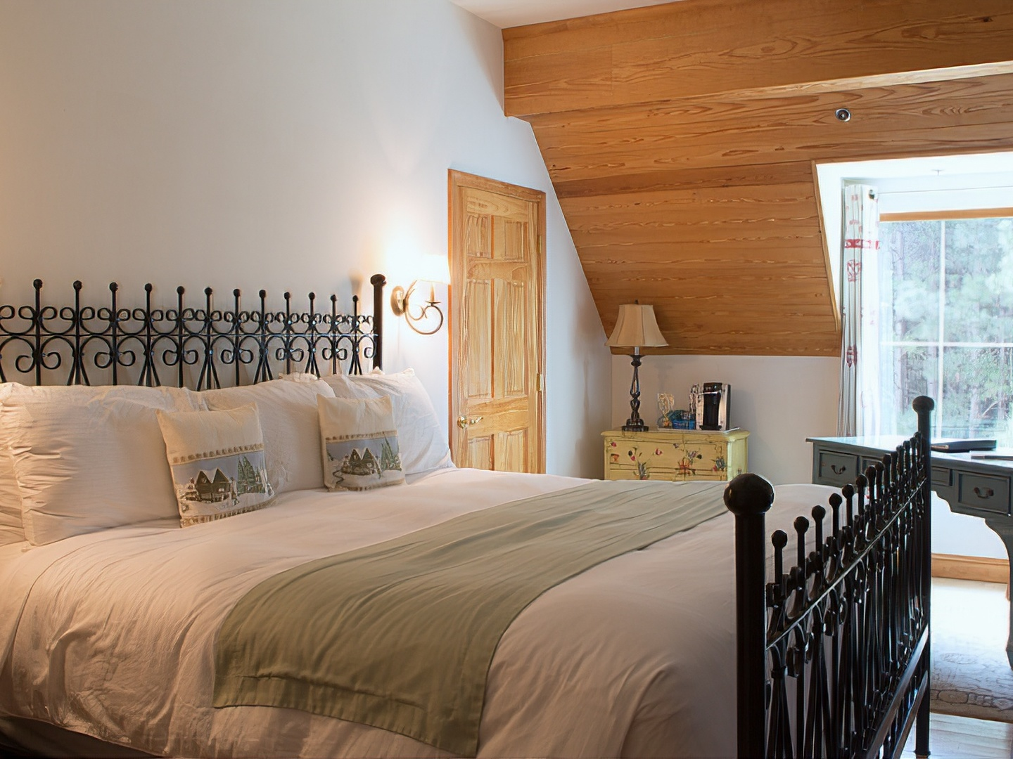 A bedroom with a large bed in a room at Wedmore Place.