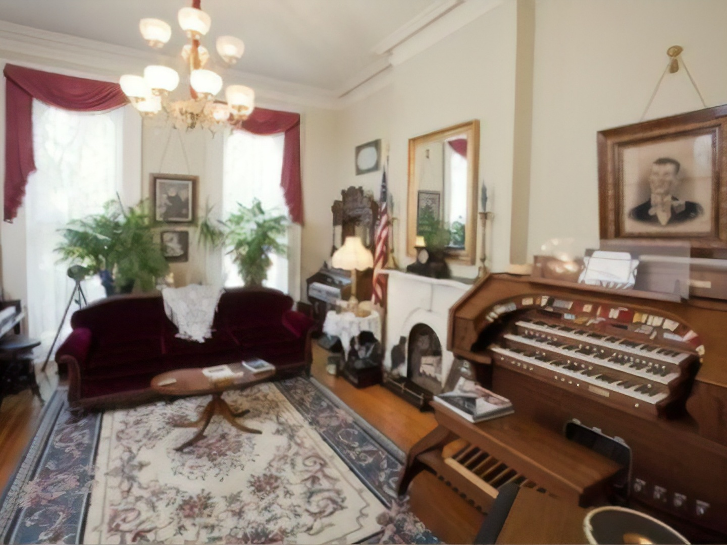 A living room filled with furniture and a fire place at Gateway Bed and Breakfast.