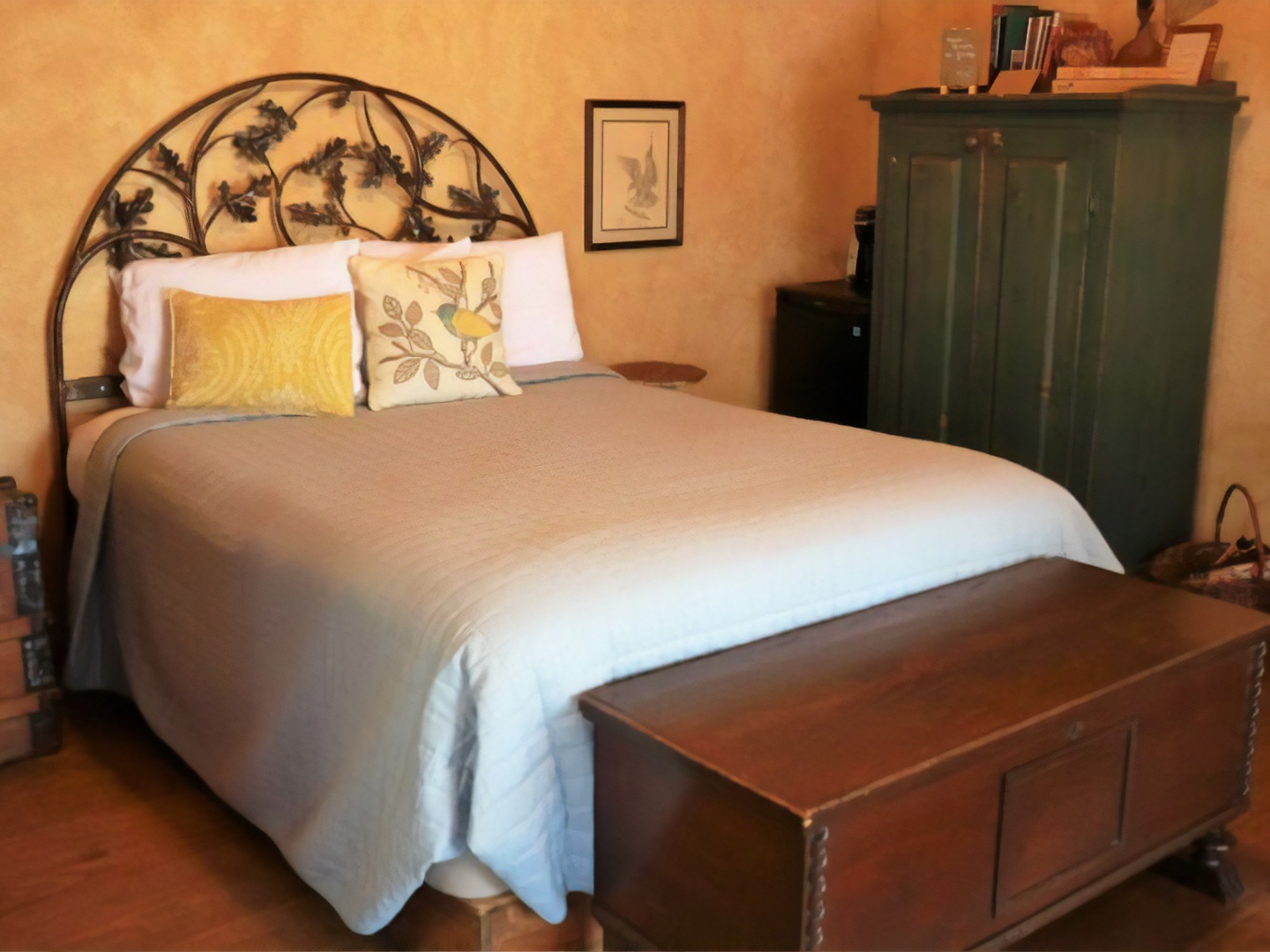 A bedroom with a bed and desk in a room at Star of Texas Bed & Breakfast.