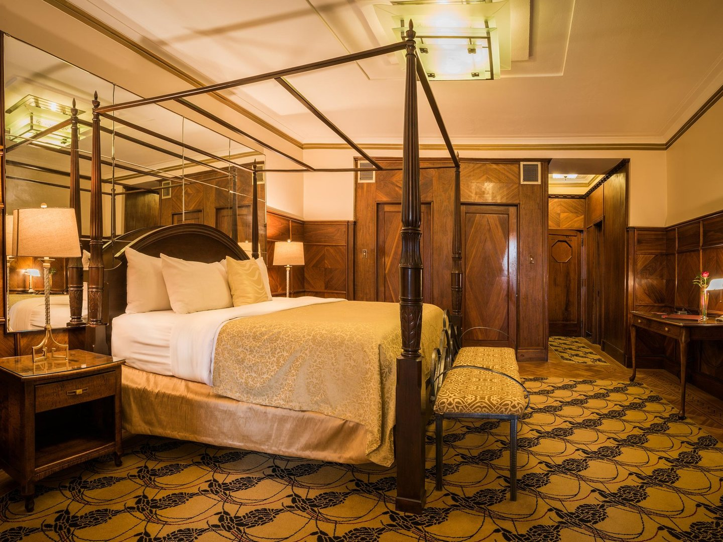 A bedroom with a large bed in a room at Le Manoir d'Auteuil.