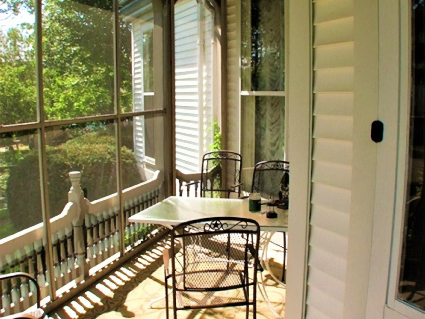 A dining room table in front of a window at Herrold on Hill Bed and Breakfast.
