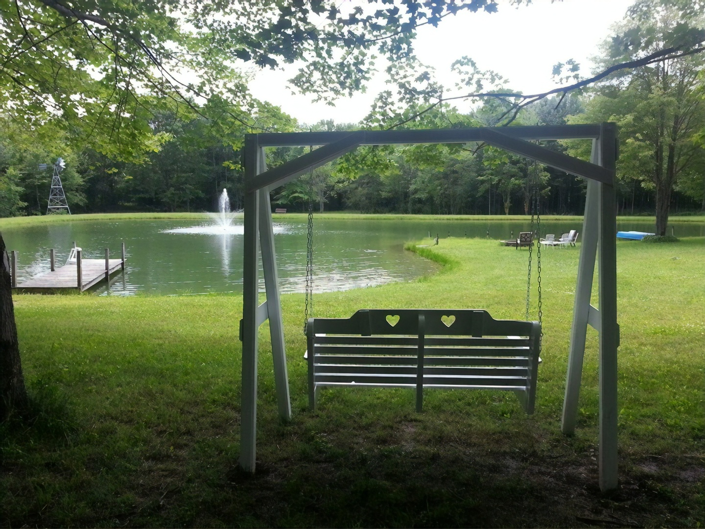 A bench sits in the middle of a lush green field at Bear Creek Farm Bed and Breakfast .