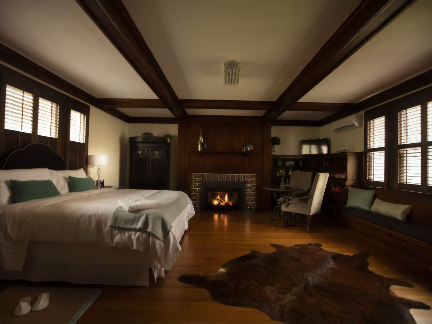 A bedroom with a large bed in a room at Nobnocket Boutique Inn.