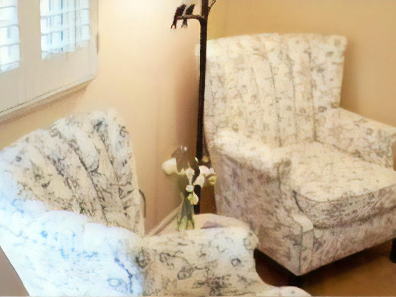A sofa in a room at Green Tree Inn of Elsah.