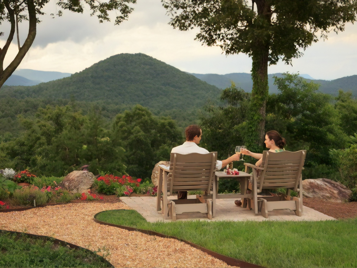 A person sitting on a bench in a park at Lucille's Mountain Top Inn & Spa.