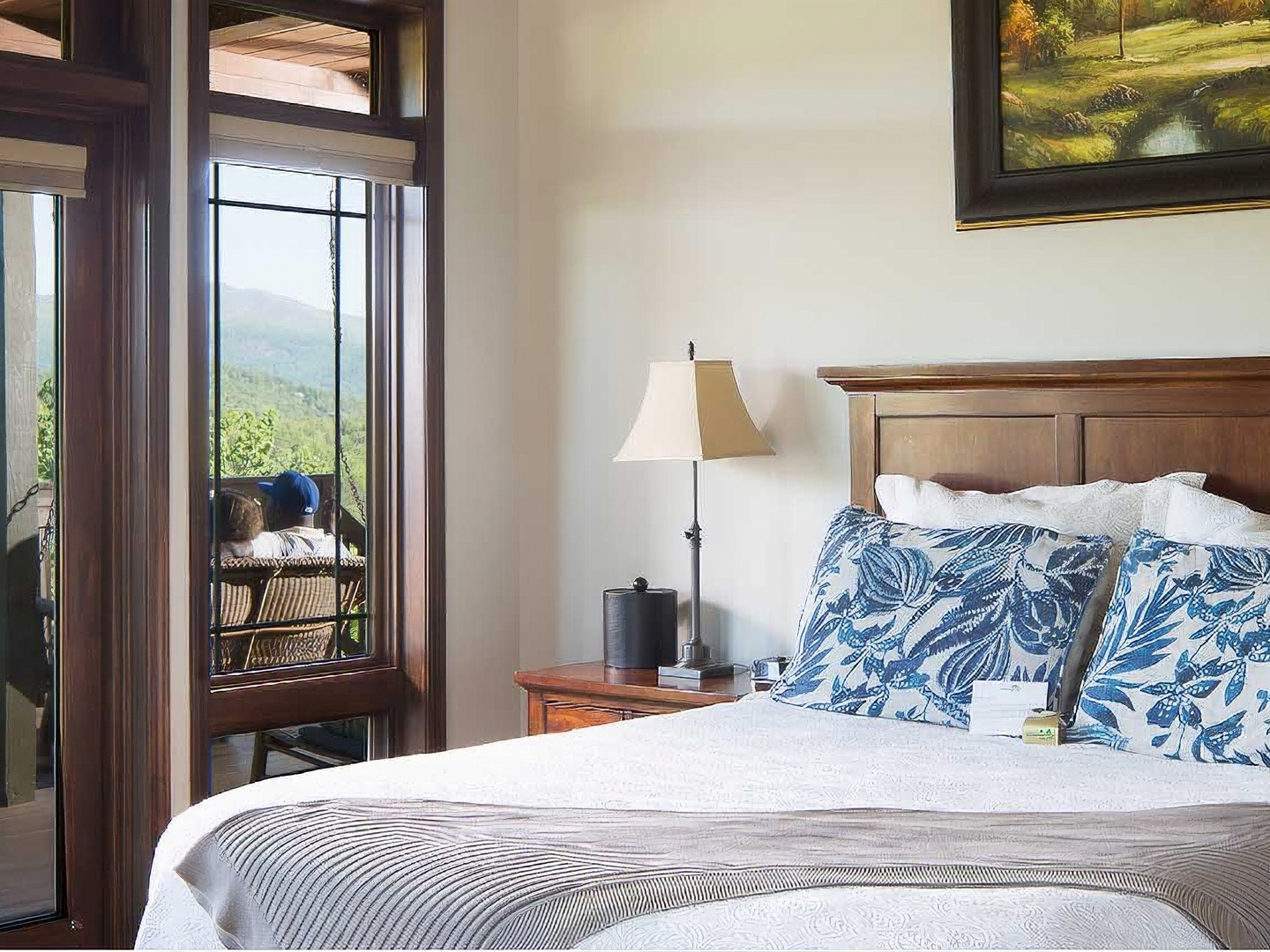 A bedroom with a bed and a window at Lucille's Mountain Top Inn & Spa.