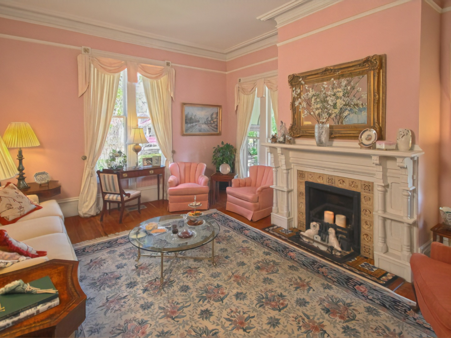 A living room filled with furniture and a fire place at Fairbanks House.