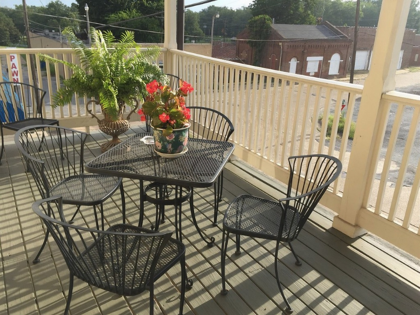 A chair sitting in front of a fence at Court Square Inn Bed & Breakfast.