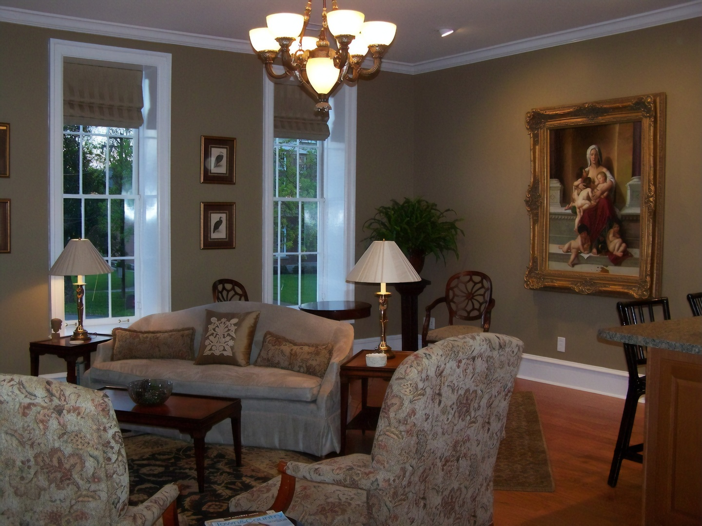 A living room filled with furniture and a fire place at Court Square Inn Bed & Breakfast.