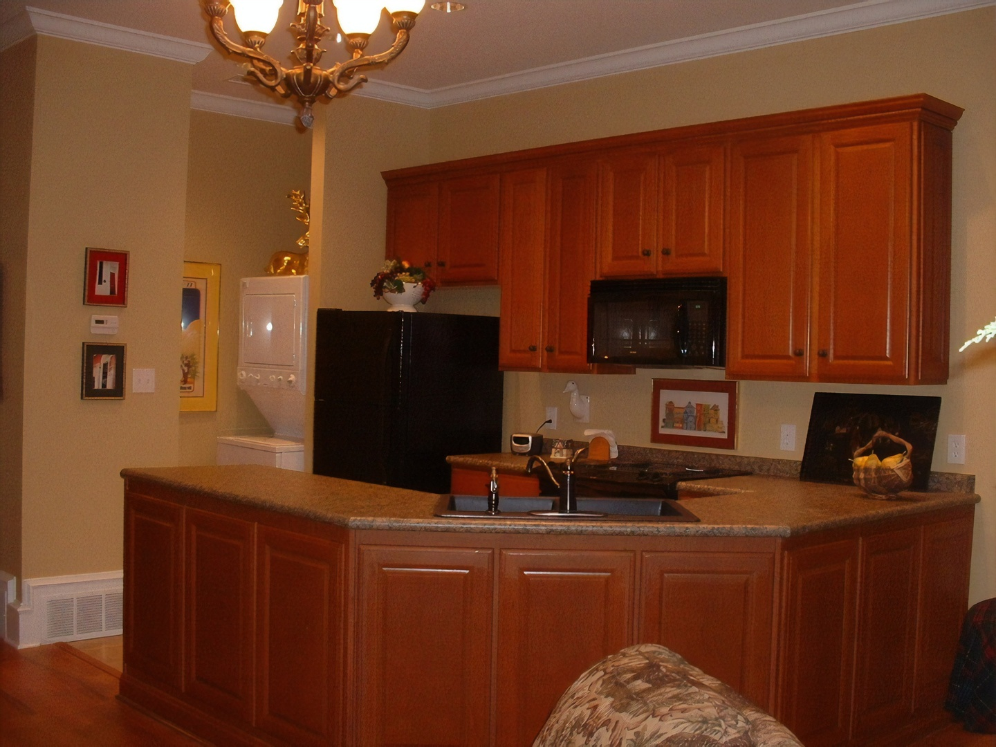 A kitchen with wooden cabinets at Court Square Inn Bed & Breakfast.