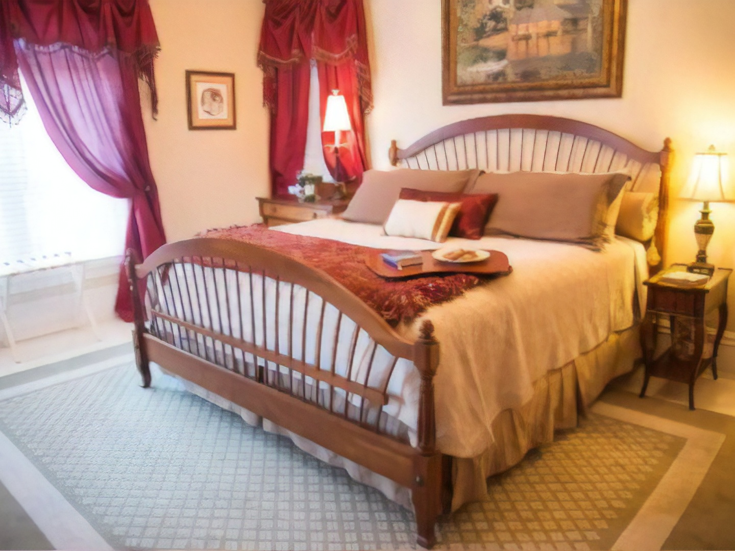 A bedroom with a bed and a chair in a room at Blessings on State Bed & Breakfast.