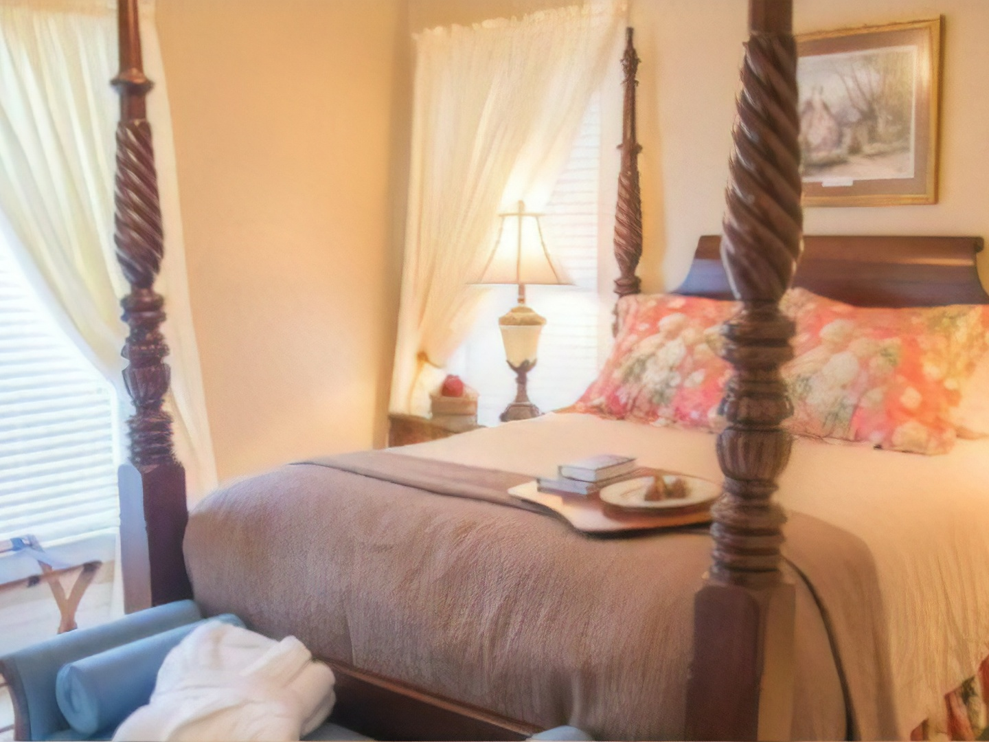 A bedroom with a lamp on a table at Blessings on State Bed & Breakfast.